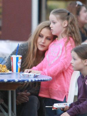 EXCLUSIVE.Coleman-Rayner.  Los Angeles, CA, USA. August 5, 2017 **Video Available** A happy and healthy-looking Lisa Marie Presley treated her twin girls Harper and Finley, nine, to a day out at the Ventura County Fair at the weekend. The only daughter of Elvis put her divorce woes behind her as she played traditional fair games, with one of girls winning a pet goldfish. Lisa cuddled up to her girls as they had food, cradling one of them on her lap. The mother and her daughters also dressed up in period-style costume for a fun photo and they browsed souvenirs at the fair's stalls. CREDIT LINE MUST READ: Coleman-Rayner Tel US (001) 310 474 4343 - office  www.coleman-rayner.com